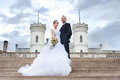 Bride and groom posing near castle Royalty Free Stock Photos