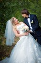 Bride and groom posing together outdoors elegant on a wedding day Royalty Free Stock Photo