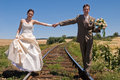 Bride and groom on rails Royalty Free Stock Images