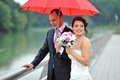 Bride and groom in the rainy day Stock Photos