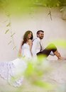Bride and groom relaxing beautiful portrait in nature Stock Photo