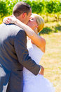 Bride and groom romantic kiss a share a on their wedding day at a winery vineyard in oregon Royalty Free Stock Photos