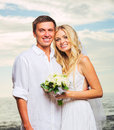 Bride and groom romantic newly married couple on the beach jus just Royalty Free Stock Photography