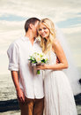 Bride and groom romantic newly married couple on the beach jus just smile Royalty Free Stock Images
