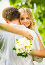 Bride and groom romantic newly married couple embracing just Royalty Free Stock Images