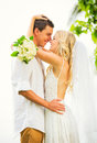 Bride and groom romantic newly married couple embracing just m fun Stock Photos