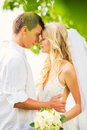 Bride and groom romantic newly married couple embracing just m on honeymoon Stock Image