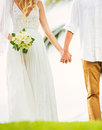 Bride and groom romantic newly married couple holding hands ju just Stock Image