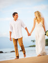 Bride and Groom, Romantic Newly Married Couple Holding Hands Wal Royalty Free Stock Photo