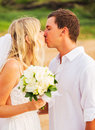 Bride and groom romantic newly married couple kissing at the be beach just Royalty Free Stock Photos