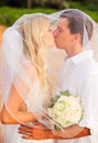 Bride and groom romantic newly married couple kissing at the be beach just Royalty Free Stock Image