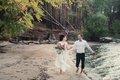 The bride and groom running on the beach, wedding accessories Royalty Free Stock Photo