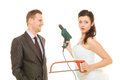 Bride and groom sharing household duties Royalty Free Stock Photo