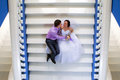 Bride and groom sitting on the stairs beautiful young Stock Photography