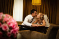 Bride and groom sitting in a stylish lounge Royalty Free Stock Photo
