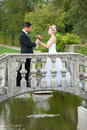 Bride and groom on a small bridge in park outdoor married couple Royalty Free Stock Images