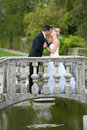 Bride and groom on a small bridge in park outdoor married couple Stock Images