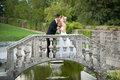 Bride and groom on a small bridge in park outdoor married couple Royalty Free Stock Photos