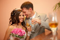 Bride and groom smiling couple with glasses of champagne Royalty Free Stock Photo