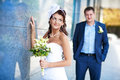 Bride and groom is standing near the granite wall Stock Photos