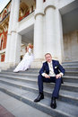 Bride and groom on steps of palace Stock Image