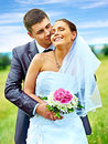 Bride and groom summer outdoor. Royalty Free Stock Image