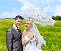 Bride and groom summer outdoor happy wedding Stock Photos