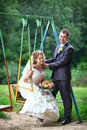 Bride and groom on swing Stock Photos