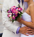 Bride and groom on their wedding day hugging Stock Image