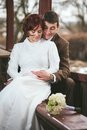Bride and groom together couple of sitting holding hands Stock Photography
