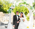 Bride and Groom Under Archway Royalty Free Stock Photo