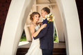 Bride and groom under stone arch Royalty Free Stock Photo