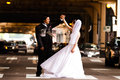 Happy Bride and Groom Dancing in the Street