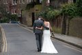 Bride and Groom walking away Royalty Free Stock Photo