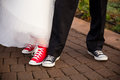 Bride and groom wear converse crow or october wearing all star shoes on their wedding day Stock Image