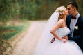 Bride and groom at wedding Day hugging Outdoors on spring nature Royalty Free Stock Photo