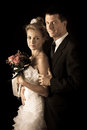 Bride and groom on wedding day isolated over black background Royalty Free Stock Images