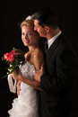 Bride and groom on wedding day isolated over black background Royalty Free Stock Photo