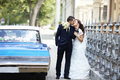 The bride and groom on the wedding day  to the car. Royalty Free Stock Photo