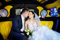 The bride and groom in a wedding limousine Stock Photo