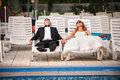 Bride and groom after wedding relaxing at the pool Royalty Free Stock Image