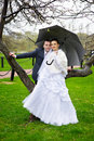 Bride and groom at wedding walk with umbrella Royalty Free Stock Image