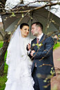 Bride and groom at wedding walk with umbrella Stock Photos