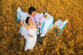 Bride and groom on the wheat field Royalty Free Stock Photo