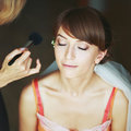 Bride having wedding make up by professional artist Royalty Free Stock Photos