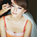 Bride having wedding make up young by professional artist Royalty Free Stock Images
