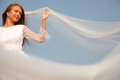 Bride with her eyes closed holding veil selective focus Stock Image
