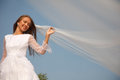 Bride with her eyes closed holding veil selective focus Royalty Free Stock Image