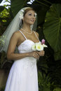 Bride on her wedding day in a tropical garden Royalty Free Stock Photos