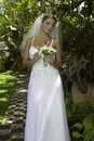 Bride on her wedding day in a tropical garden Royalty Free Stock Images